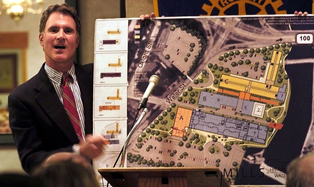 Developer Paul Boghossian holds a drawing of the Lockwood Mills complex in Waterville, including CF Hathaway Co. mill, in a presentation to members of the Waterville Rotary Club in 2008. Tuesday it was announced that he sold the remaining two Lockwood mills to the North River Company, the current owner of the Hathaway Creative Center.